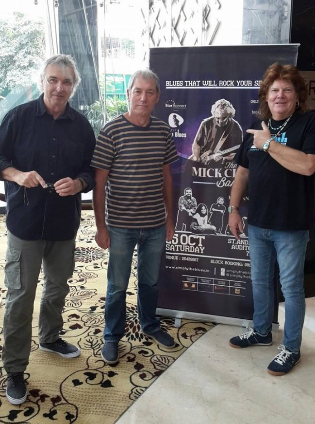 The Mick Clarke Band with poster for Simply The Blues, Mumbai - October 2014 Photo by Anil Mehta